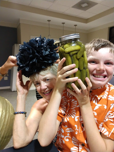 Look, Grandma LInda brought a big jar of homemade pickles.